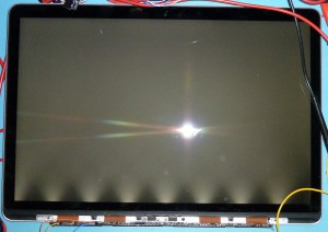 The Macbook Pro Retina LCD assembly, with the panel plus one LED array powered.